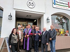 Wilson cuts the ribbon to re-open the Clothesline Community Thrift Store